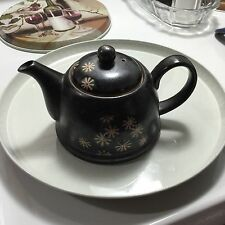 Tea Pot with strainer by ! Wun Brown with Tan flowers with red centers