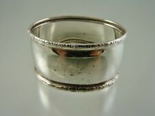SCROLL BORDER OVAL NAPKIN RING BY BIRKS STERLING
