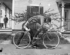 Early1900s Walter F. Marble glass negative. The Bicycle Racer - side view.