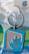 WINTER OLYMPICS METAL KEYCHAIN - VANCOUVER 2010 - LIGHT BLUE MAPLE LEAF DESIGN