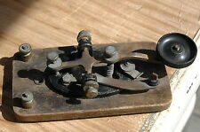 Antique vintage morse code telegraph key on wooden base