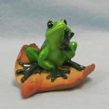 Tree Frog on Brown Leaf with Hand on Chin Figurine