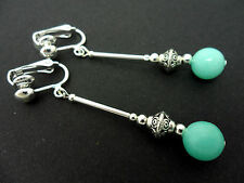 A PAIR OF DANGLY PALE BLUE JADE  SILVER PLATED CLIP ON   EARRINGS.
