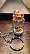 5 Skulls and New Mexico White Sand Key Chain Glass Corked Bottle