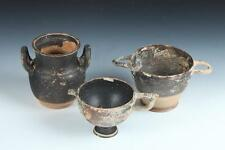 THREE GREEK ATTIC BLACK TERRACOTTA SKYPHOS. - Largest: 6 3/4 in. long. Lot 1174