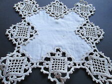 Antique handmade crochet lace doilie on white linen