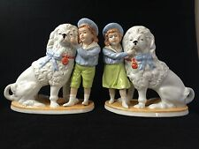 antique porcelain staffordshire dogs. Marked pair with boy and girl - 1927