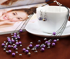 MULTI-STRAND FLOATING PURPLE  PEARL NECKLACE AND EARRINGS SET