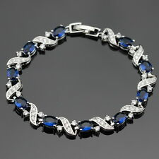 Sterling Silver Blue Sapphire, White Topaz 11ct Tennis Bracelet Curved cross 8""