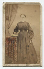 CDV CIVIL WAR ERA WOMAN STANDING AT TABLE WITH BOOKS. TINTED. MYERSTOWN, PA.