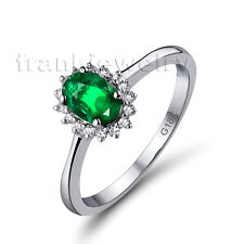 In 18K White Gold Diamond 4x6mm Oval Emerald Wedding Ring WU0128