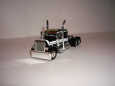DCP 1/64 BLACK WITH WHITE STRIPES 379 PETERBILT AND 36'' FLAT TOP SLEEPER