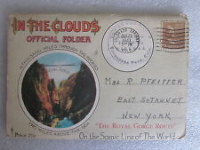 1943 In The Clouds Rocky Mountains postcard album folder with 18 pages inside