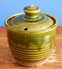 A handmade studio pottery lidded condiment Jar