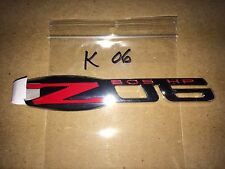 Corvette Z-06 fender Emblem GM 15812355 2006,2007,2008 red/chrome 505 hp GM NEW