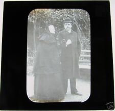 Glass Magic lantern slide SERIOUS LOOKING OLD LADY WITH GENT IN BOWLER C1910