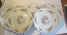 7 assiettes moyennes «Cerabel  Porcelaine de Baudour » avec fleurs
