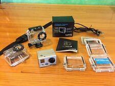 GoPro HD Hero2 w/LCD viewer bundled w/waterproof housings, 64GB card, cord etc.