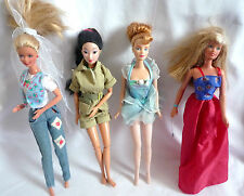 4 BARBIE DOLLS WITH FASHION OUTFITS
