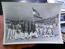 1959 SNAPSHOT PHOTO, CHINESE SPORTS TEAM WITH FLAG, IN CHINA?