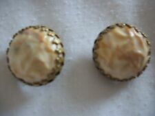 This is a Pair of Vintage Clip-on Yellow Stone Earrings with Marbleizing (#0160)