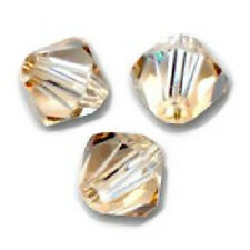 20 Toupies 4mm Cristal Swarovski  - CRYSTAL GOLDEN SHADOW  -  coupe 5328 XILION