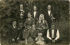 PEASANTS FAMILY OUTDOOR PORTRAIT, WOMAN WITH KITTEN ca 1920s REAL PHOTO POSTCARD