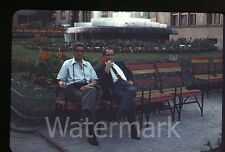 1960s 35mm   photo slide  Guys sitting on a bench  Man with camera
