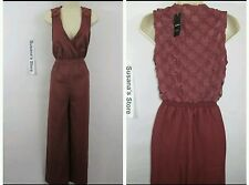 NWT BEBE ANI CROCHET BACK JUMPSUIT SIZE XL Dream crepe jumpsuit elevated by chic