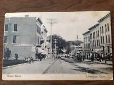 Torrington CT Dirt Water Street Store Fronts Postcard. Made in Germany 1901-1907