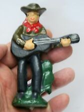 """Unusual Cast Iron    Singing Cowboyl with Guitar Bottle Opener    4 1/2"""" Tall"""