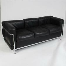 Le Corbusier LC2 black leather and chrome three seat sofa by Cassina. Lot 221