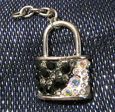 Charm in the shape of a padlock with black and white stones. About 2 inches long