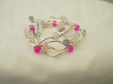 Set Of Four My Fun Color Stetch Bracelets In Shades Of Pink And Clear