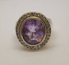 Sterling silver amethyst and synthetic diamond cluster engagement dress ring