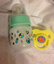 BABY ALIVE/SURPRISE BABY ALIVE 2 OZ GREEN BOTTLE AND YELLOW DUCK PACIFIER