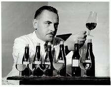 1942 Vintage Photo wine taster studying clarity & color from South Africa winery