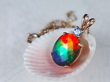 Impressive grade AA faceted ammolite pendant.Bright red green blue #062226**