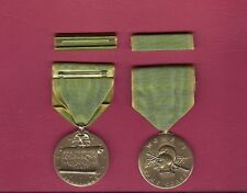 One full size WWII Women's Army Corps medal with ribbon bar WAC