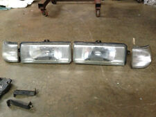 87 mazda 626  headlight assembly's both left and right and both parking light's