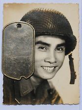Wartime Studio Picture of an ARVN Soldier w/ Helmet and Camouflage Net
