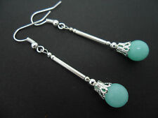 A PAIR OF PALE BLUE JADE SILVER PLATED  DANGLY   EARRINGS. NEW.