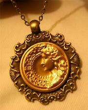 Delightful Swirled Rim Shell Festooned Lady With Flowing Hair Pendant Necklace