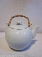 CONTEMPORARY WHITE PORCELAIN AND BAMBOO HANDLE PERSONAL TEA POT