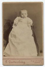 CABINET CARD BABY WITH BIG BLUE EYES IN WHITE GOWN. CINCINNATI, OHIO.