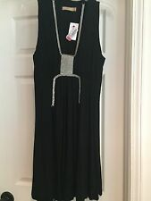 Womens Dress Sz 7 Black jersey ties in back and has diamond accent Brand New