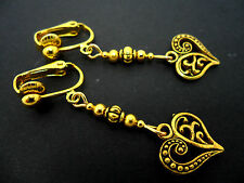 A PAIR OF DANGLY GOLD COLOUR   HEART  CLIP ON EARRINGS.  NEW.