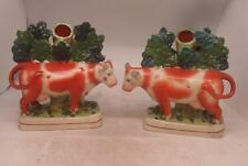 Staffordshire Pottery Pair of Figures - Cow Spill Vases with Tree Bocage
