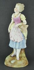 """German early 1900's bisque figurine of girl with basket. 10 ½"""" tall. (BI#MK/TMP)"""