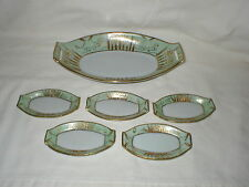 NIPPON HANDPAINTED GOLD APPLIED DAFFODIL CELERY DISH AND FOUR SALT DISHES